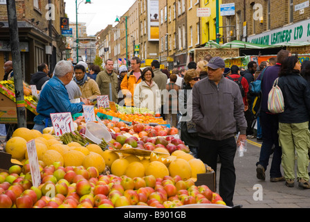 Food stalls in Brick Lane street during Sunday market in East London England UK - Stock Photo