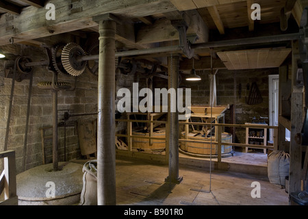Restored workings inside Stainsby Mill a working water powered flour mill on the Hardwick Hall Estate Derbyshire - Stock Photo