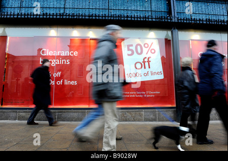January sales discounts advertised in shop front in Cambridge, Cambridgeshire, England - Stock Photo