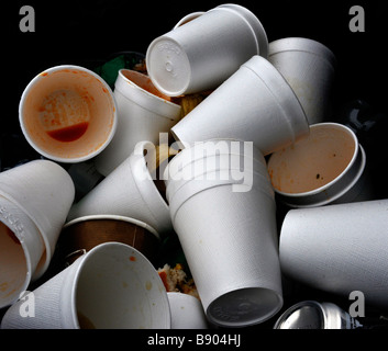 digarded polystyrene drinking cups in rubbish bin - Stock Photo