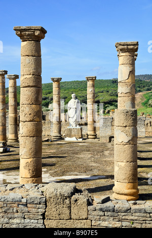 Roman ruins of Baelo Claudia at Bolonia Cadiz Province Spain Statue of the Emperor Trajan in the Basilica beside - Stock Photo