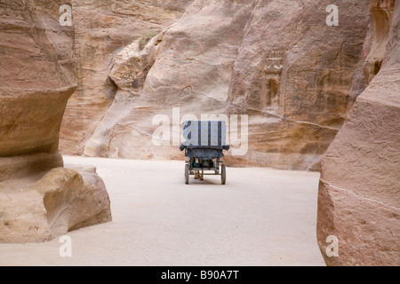 A horse and cart carriage making its way through the Siq at the entrance to Petra, Jordan - Stock Photo