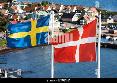Swedish and Danish flags Sweden. - Stock Photo