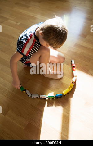 A boy playing with a train Sweden. - Stock Photo