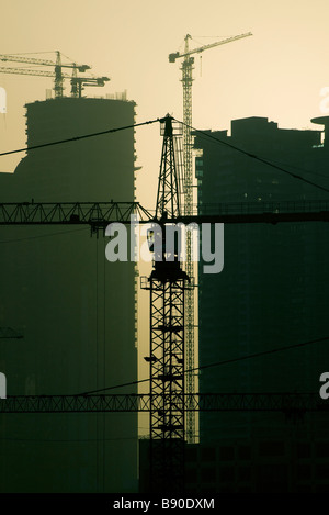 cranes on construction site, dubai, uae - Stock Photo