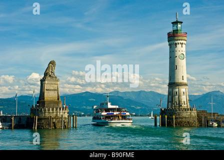 Lindau harbor entrance looking at swiss alp panorama Lake Constance Germany | Passagierschiff in der Hafeneinfahrt - Stock Photo