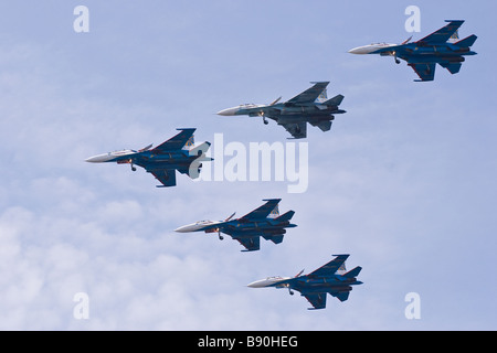 The Russian Knights aerobatic team at air show - Stock Photo