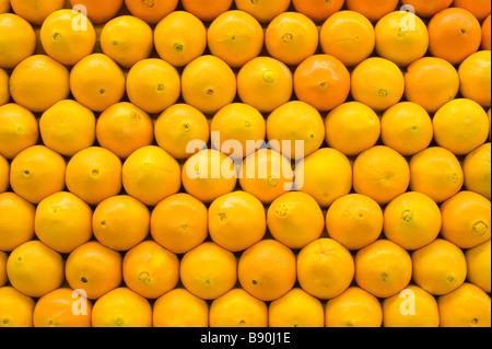 Bright Oranges lined up symmetrically - Stock Photo