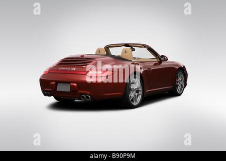 2009 Porsche 911 Carrera 4S in Red - Rear angle view - Stock Photo