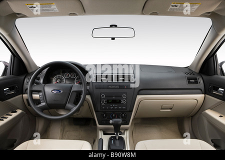 2009 Ford Fusion S in White - Dashboard, center console, gear shifter view - Stock Photo