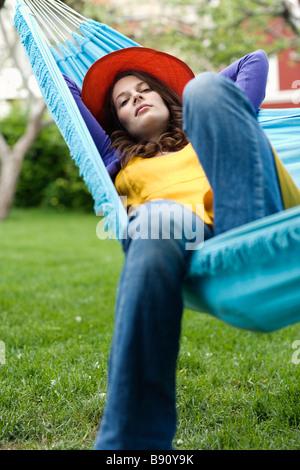 Portrait of a Scandinavian woman in a hammock. - Stock Photo