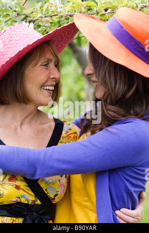 Two women hugging Sweden. - Stock Photo
