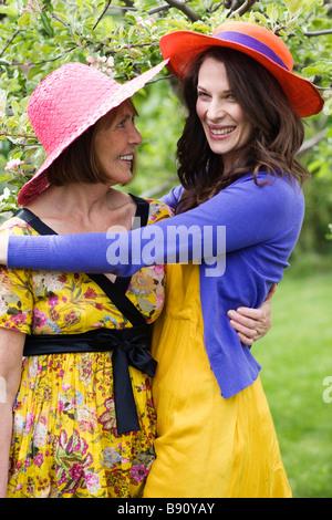 Two women hugging Sweden. - Stock Photo