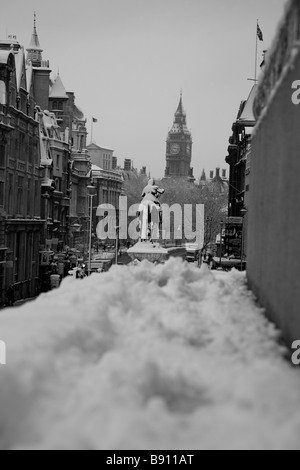 Snowy view from Trafalgar Square down Whitehall towards Big Ben, Houses of Parliament, London - Stock Photo