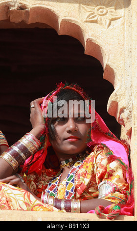India Rajasthan Jaisalmer rajasthani girl in a window - Stock Photo
