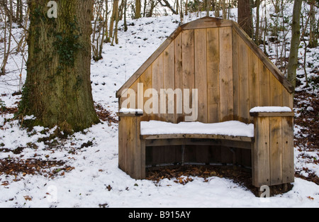 Wooden seat in Rock Park and Spa Llandrindod Wells Powys Mid Wales UK - Stock Photo