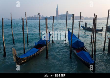 Italy Veneto Venice view of Gondolas from Piazza San Marco with San Giorgio Maggiore in the background - Stock Photo