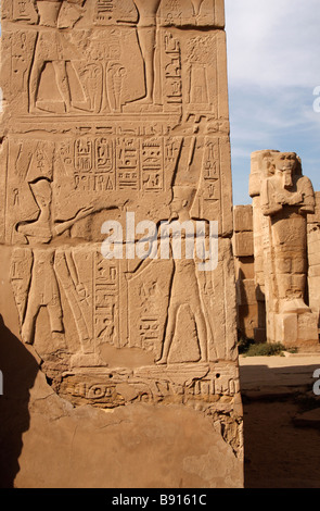Ancient Egyptian hieroglyphics and wall relief showing pharaoh and god Amun, close up detail, Karnak Temple, Luxor, - Stock Photo