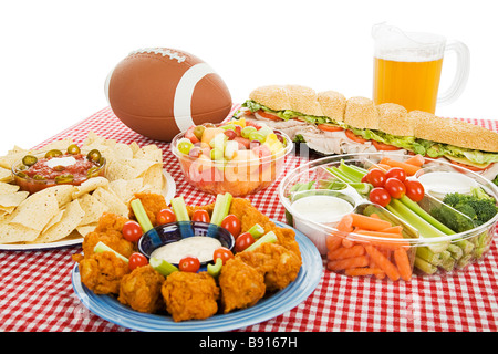 Table spread with appetizer trays for the footbal party Horizontal view over white background  - Stock Photo