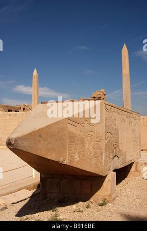 Pyramidion tip of fallen Obelisk of Queen Hatshepsut, two standing obelisks in background, Karnak Temple, Luxor, - Stock Photo