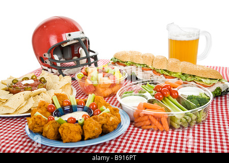 Table set with munchies for a Super Bowl party White background  - Stock Photo