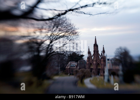 Creepy old church in a cemetery - Stock Photo