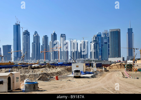 Dubai big construction building site with many high rise skyscrapers some completed some work in progress with cranes - Stock Photo