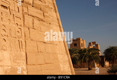[Medinet Habu] Temple complex, hieroglyphics carved on wall of First Pylon, 'Syrian Gate' behind, 'West Bank', Luxor, - Stock Photo