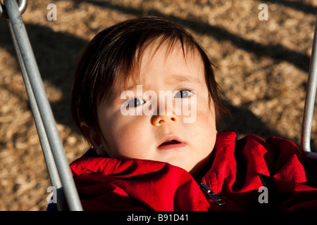9 Month Old Baby Swinging In The Park