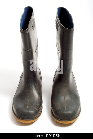 Old pair of wellington boots on white background - Stock Photo