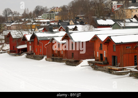 The wooden sheds along the frosen river of Porvoo in the old town of Porvoo, Finland, Scandinavia, Europe. - Stock Photo