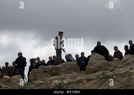 Israeli soldiers blocking passage to Palestinian villagers in the West Bank Israel - Stock Photo