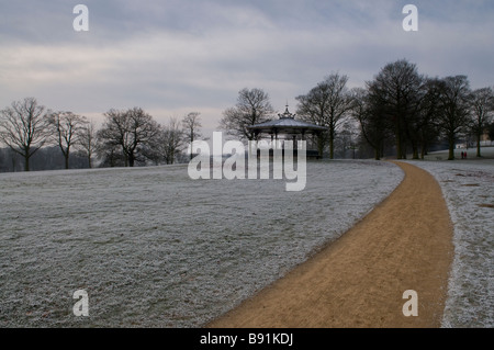 A frosty path leading to the Victorian bandstand in Roundhay Park, Leeds, England in the winter - Stock Photo