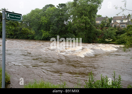 A Footpath Sign Marks The Site Of A Set Of Submerged Stepping Stones Crossing The River Wharfe, Ilkley. - Stock Photo