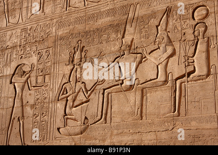 Egyptian wall relief scene. God Thoth, Ramses II,  Theban family triad of Amun, Mut and Khonsu. Ramesseum Temple, - Stock Photo