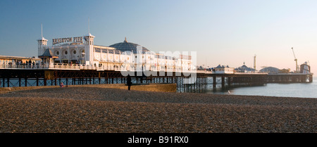 Low Winter sunlight on Brighton Pier, Brighton, East Sussex, England, UK - Stock Photo