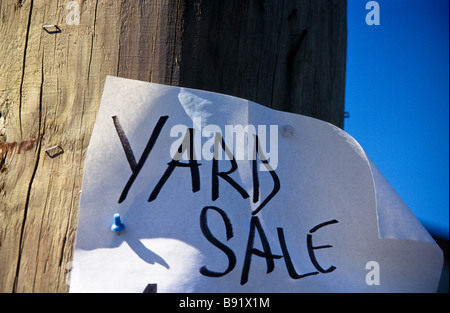 Hand made poster on utility pole for local yard sale - Stock Photo