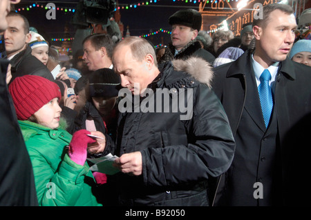 Russian President Vladimir Putin visits the Red Square skating rink next to the Kremlin - Stock Photo