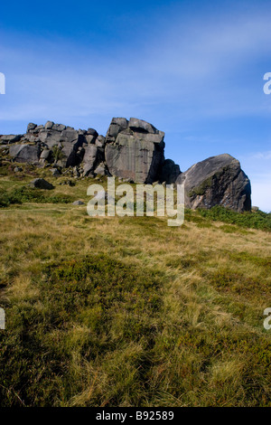 Beautiful rural scenic landscape of dramatic bright blue sky over high sunlit rocky outcrop - Cow and Calf Rocks, - Stock Photo