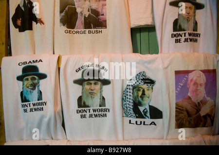 T- shirt souvenirs for sale at the old city market in East Jerusalem Israel - Stock Photo