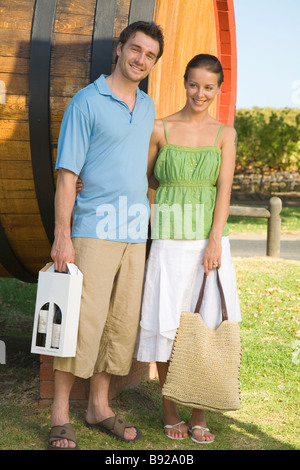 Young couple standing at Wine Estate after purchasing wine Cape Town Western Cape Province South Africa - Stock Photo