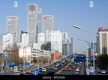 View across highway to highrise buildings in new Central Business District CBD in Chaoyang Beijing 2009 - Stock Photo