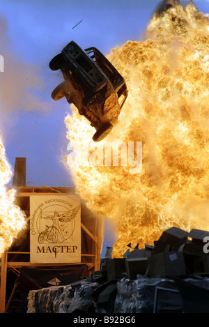 A car jumping through fire during a show at the 6th Moscow international festival of the art of special effects - Stock Photo