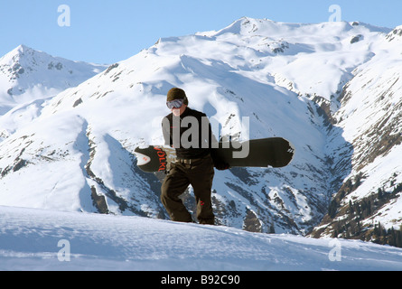 Pepi Ahonen, Swiss Freeriding Snowboard World Champ, walking in snow - Stock Photo