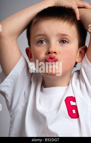 Little boy mimicking a monkey - Stock Photo