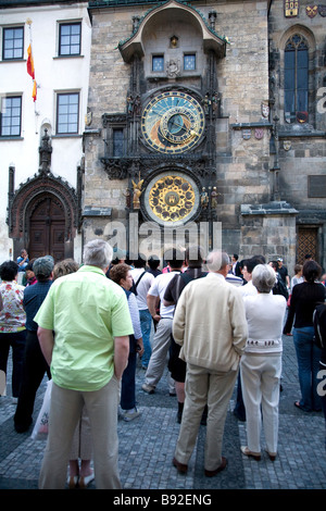 Crowds gather on the hour to observe the Astronomical Clock with its medieval understanding of the world Prague - Stock Photo