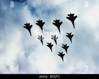 Ten Mikoyan Gurevich MiG 29 Fulcrum and Sukhoi Su 27 Flanker fighters from the Russkiye Vityazi Russian Knights - Stock Photo