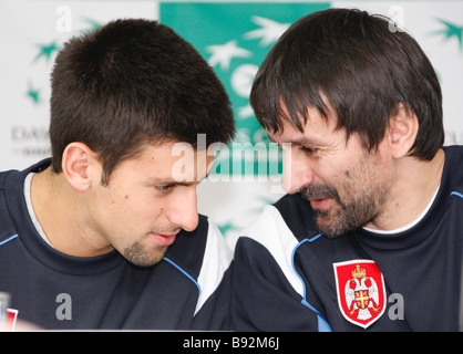 Serbian tennis player Novak Djokovic and captain of the Serbian team Bogdan Obradovic left to right at a press conference - Stock Photo