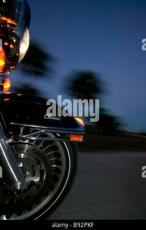 Front wheel of Harley Davidson driving down Hwy 41 near Everglades City FL - Stock Photo