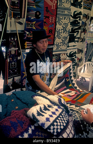 1, one, Ecuadoran man, vendor, Otavalo Market, Indian market, Plaza de los Ponchos, town of Otavalo, Imbabura Province, - Stock Photo